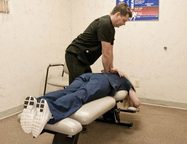 chiropractor adjusting a patient